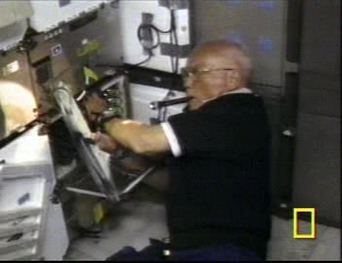 Sen. John Glenn on the Space Shuttle mission on which the aerogel experiment flew (image credit NASA, National Geographic Channel)
