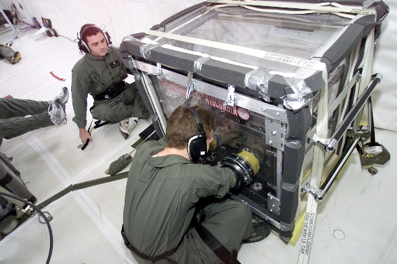 Mark Schneider (left) and Stephen Steiner (right) making silica alcogels on NASA's KC-135A (image courtesy of Stephen Steiner).