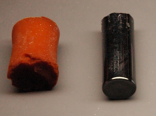 A resorcinol-formaldehyde polymer aerogel (left) and a carbon aerrogel (right)